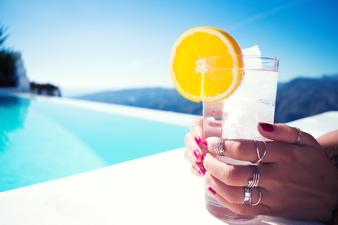 Spain-holiday-CasaMiranda-pool-view-enjoy-sparklingwater-orange